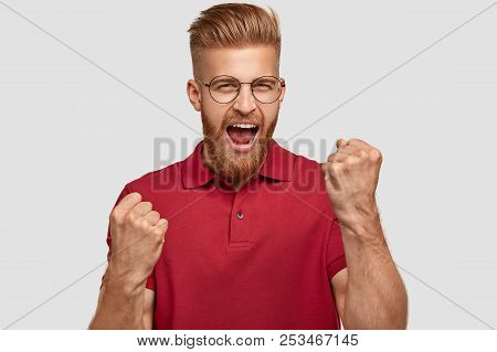 Yeah, I Did It! Successful Happy Ginger Male With Trendy Haircut, Clenches Fists, Has Overjoyed Expr
