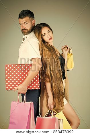 Shopping And Sale. Fashion Shopaholic Couple. Girl And Bearded Man Hold Present Pack, Cyber Monday.
