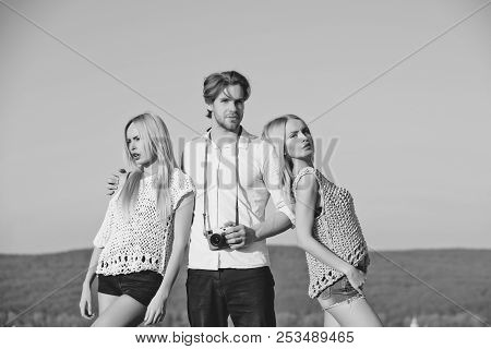 Sexy Girls And Handsome Man Or Photographer With Camera Posing On Idyllic Mountain Landscape On Sunn
