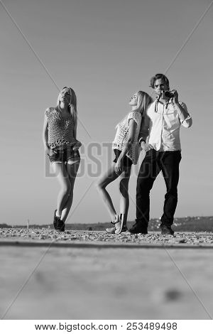 Man Or Photographer With Camera And Pretty Women Or Sexy Girls, Fashionable Female Models Posing On