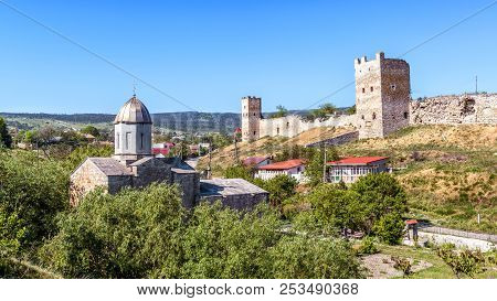 Genoese Fortress In Feodosia, Crimea, Russia. Beautiful Scenic View Of The Medieval Ruins On The Cri