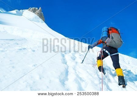 Hiker With Backpacks Reaches The Summit Of Mountain Peak. Success Freedom And Happiness Achievement
