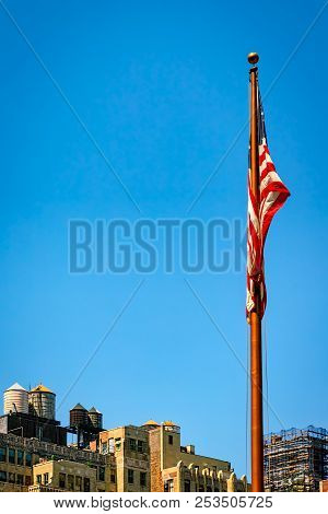A Flag Sits Idle On A Windless Day In New York City.