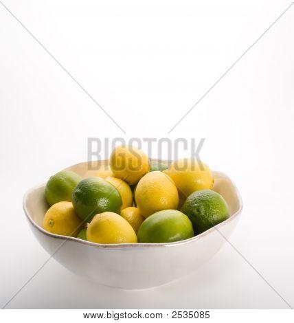 Bowl Of Lemons And Limes On White.
