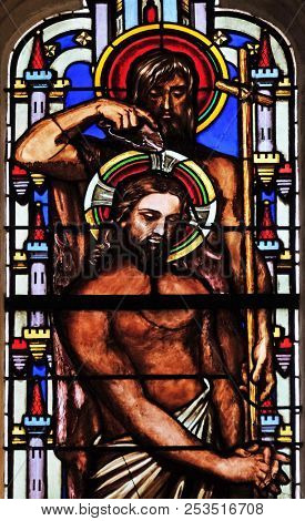 PARIS, FRANCE - JANUARY 09: Baptism of the Lord, stained glass window from Saint Germain-l'Auxerrois church in Paris, France on January 09, 2018.