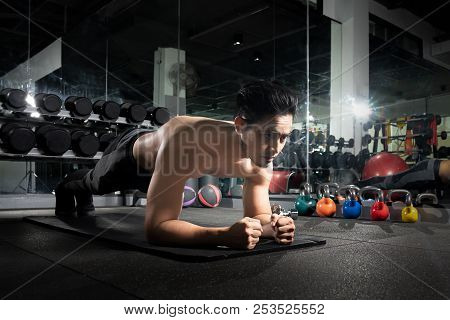 Sport. Young Athletic Man Doing Push-ups. Muscular And Strong Guy Exercising, Portrait Of A Handsome