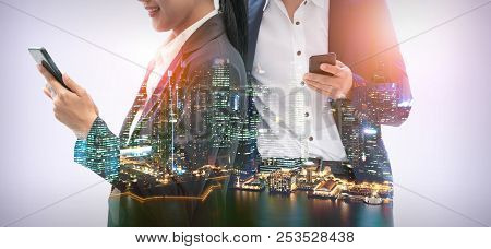 Young Business People Using Mobile Phone With Modern City Buildings Background. Future Telecommunica
