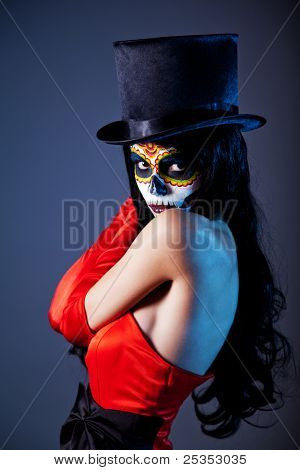 Sugar skull girl in tophat and red dress, studio shot poster
