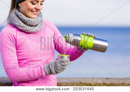 Woman Athlete Fit Girl Wearing Warm Sporty Clothes Outdoor In Cold Weather Drinking Hot Tea From Vac