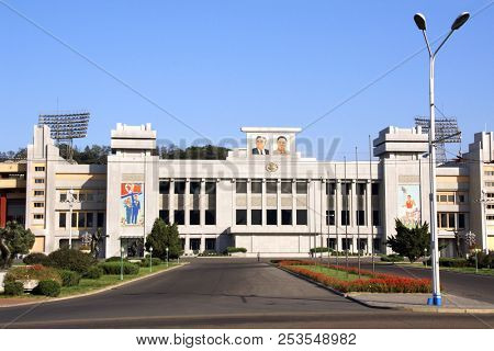 NORTH KOREA, PYONGYANG - SEPTEMBER 14, 2017: Central  stadium with portraits of two presidents DPRK Kim Il Sung and Kim Jong Il