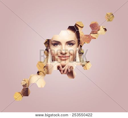 Beautiful face of young, natural and healthy woman over fallen leaves. Healthcare, spa, makeup and face lifting concept with honeycomb grid over autumn background.