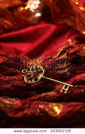 Antique Golden Key On Red Fabric Background