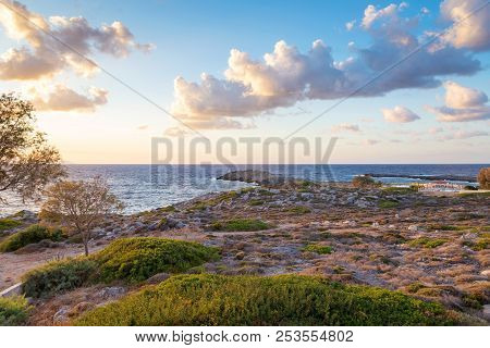 The Deserted Sea Shore Of Northern Crete In Sunset Light