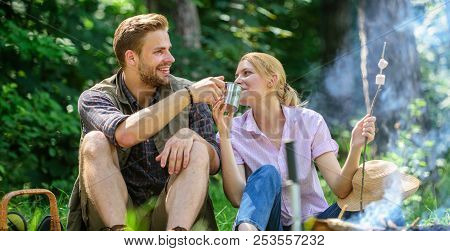Weekend Picnic. Food For Hike And Camping. Couple Sit Near Bonfire Eat Snacks And Drink. Couple Take