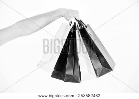 Male Hand Holds Five Shopping Bags. Shopping Concept. Hand Holds Bunch Of Colorful Shopping Bags. Sh