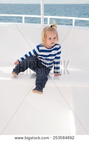 Vacation Concept. Little Kid Enjoy Vacation Trip. Baby On Summer Vacation. Vacation On Sea. Welcome