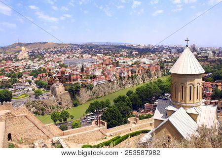 Aerial view on Tbilisi, georgian orthodox church, old traditional houses over Kura river (Mtkvari  river), Georgia