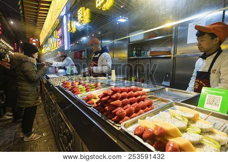 Beijing, China - Mar 17, 2018: People Visiting The Wangfujing Snack Street In Beijing. It Is A Night