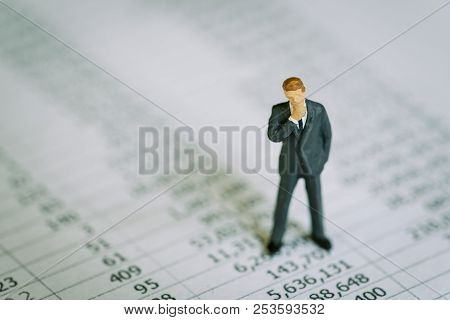Business Profit And Loss, Investment Data Or Financial Report Concept, Miniature Businessman Standin