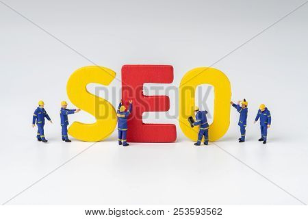 Seo, Search Engine Optimization Ranking Concept, Miniature People Figure Workers Team Building Alpha