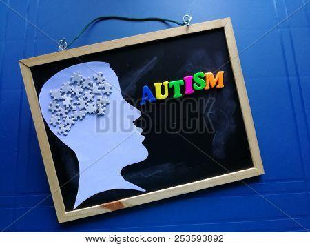 Autism concept, puzzle on head silhouette