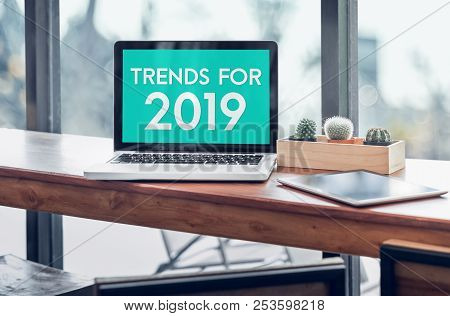Trends For 2019 Word In Laptop Computer Screen With Tablet On Wood Stood Table In At Window With Blu