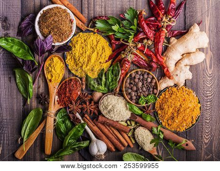Heaps Of Various Ground Spices On Wooden Background. Georgian Spices, Indian Spices, Arabian Spices.