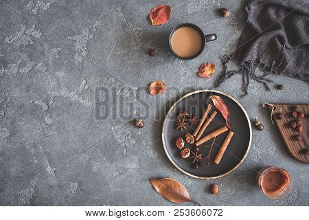 Autumn Cozy Composition. Cup Of Coffee, Plaid, Dried Leaves On Black Background. Autumn, Fall Concep