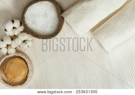 Spa Background. Fluffy Flower Of Cotton Plant, Sea Salt, Clear Rolled Towels, Round Soap On White Wo