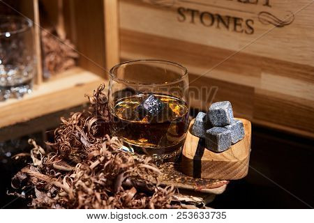 Irish Whiskey. Glass Of Whisky With Wiskey Stones. Elegant Glass Of Whiskey With Whiskey Stones. Sco