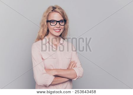 Young Lovely Caucasian Curly-haired Gorgeous Woman Wearing Formal Wear And Eye Glasses, Folded Hands
