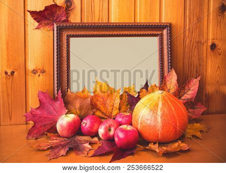 Apples, Pumpkin, Maple Leaves And Picture Frame. Autumn Concept.