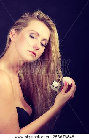 Smell, Elegance Concept. Beautiful Elegant Blonde Woman With Necklace Holding And Applying Perfume A