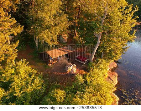 Aerial Drone View Of Log Cabin Lean To Campsite And Campfire In The Adirondack Mountains Of Upstate