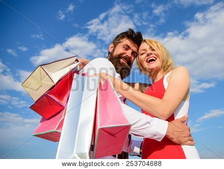 Man Beard And Blonde Girl Enjoy Buy Clothing. Shopping Brings Positive Emotions. Family Bought Excel