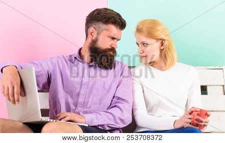 Find compromise. Couple with laptop going to watch movie. Family spend leisure together. Couple choosing movie and have opposite opinion. What we going to watch. Couple different opinion about movie poster