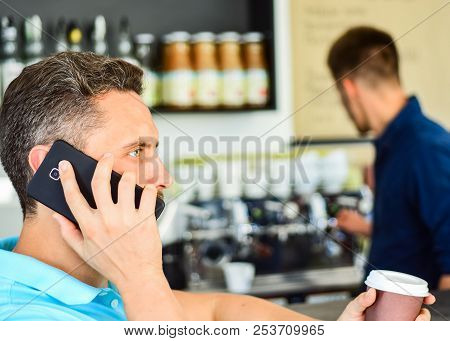 Man Holds Cup Of Drink While Have Mobile Conversation. Coffee To Go Useful Option For Busy People. C