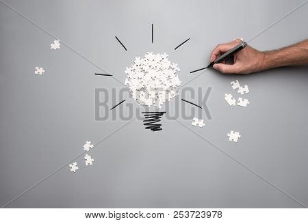 Conceptual Image Of Business Vision And Idea With A Pile Of White Scattered Puzzle Pieces Forming A