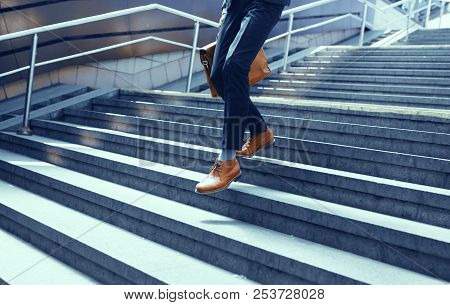 Cropped Picture Of Guy In Suit Walking Down Stairs. Businessman Dressed In Suit And Leather Shoes Wa