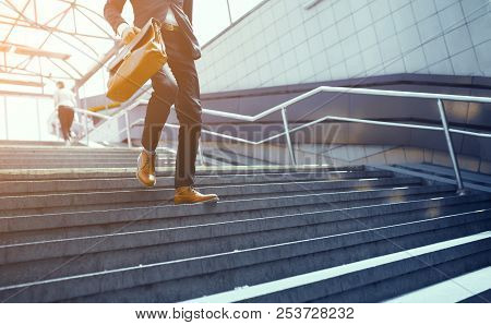 Businessman In Suit Walking Down On Concrete Steps. Stylish Business Worker Wearing Formal Clothes M