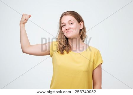 Positive Joyful European Woman Showing Hand Muscles. Middle Aged Caucasian Woman In Casual Wear Flex