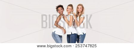 Group Of Young Multi-ethnic Attractive Girls Wearing White Shirts, Smiling And Having Fun Together,