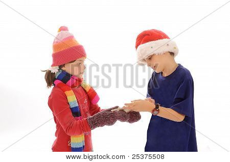 Cute little winter girl and boy with snowflake