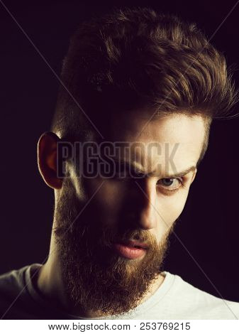 Serious Hipster. Man Or Bearded Young Hipster Has Mustache And Beard On Serious Face And Fashionable
