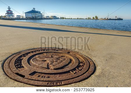 New Orleans, Usa - Nov 26, 2017: Close View Of Cast Iron Roadside Drain Plate. New Canal Lighthouse