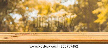 Wooden Board Empty Table Blurred Background. Perspective Brown Wood Table Over Blur Trees Forest Bac