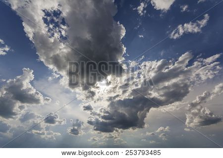 Fantastic panorama view of bright white puffy clouds lit by sun spreading against deep blue summer sky moving with wind. Beauty and power of nature, meteorology and climate changing concept. poster