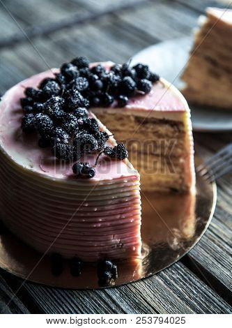 Cake With A Pink Tint With Blueberries A