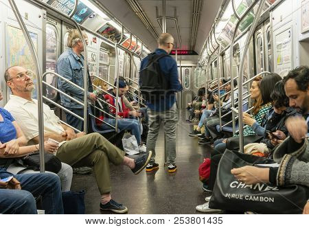 New York, Usa - May 11, 2018: Commuters Travelling In A Subway Train In New York City