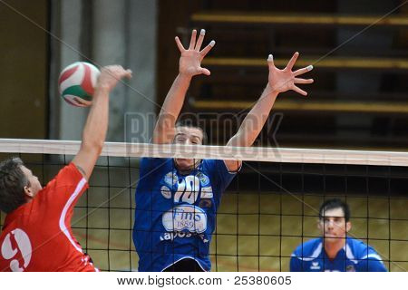 KAPOSVAR, HUNGARY - NOVEMBER 13: Unidentified players in action at a Hungarian National Championship volleyball game Kaposvar (blue) vs. Nyiregyhaza (red), November 13, 2011 in Kaposvar, Hungary.